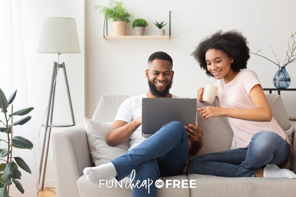 Couple looking at finances on their couch, from Fun Cheap or Free