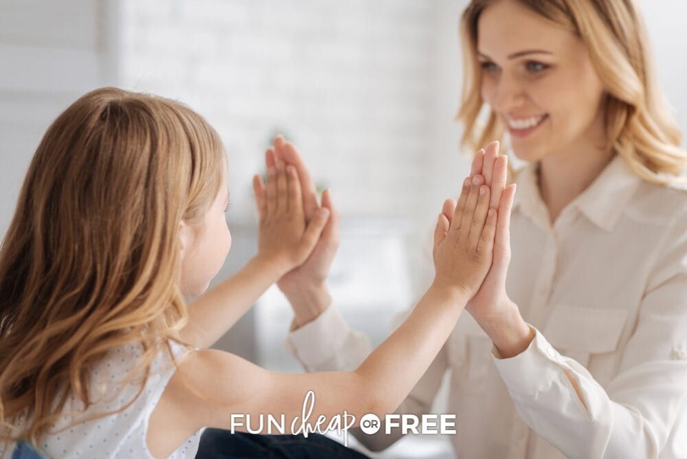 mom and daughter giving high five, from Fun Cheap or Free
