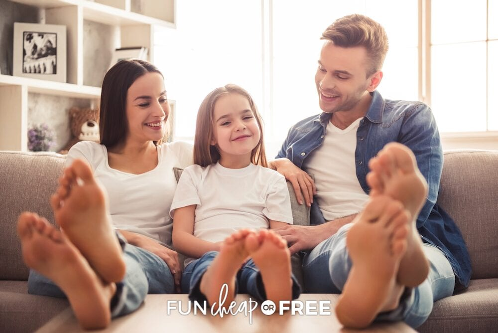 family sitting together on a couch, from Fun Cheap or Free