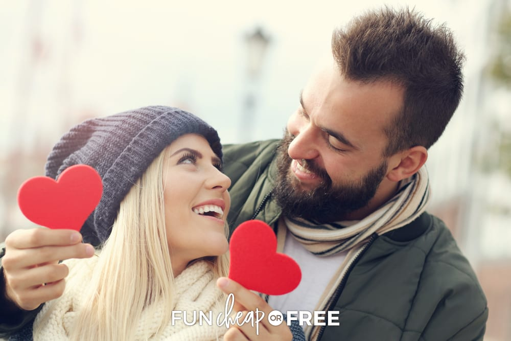 couple holding hearts for Valentine's Day, from Fun Cheap or Free
