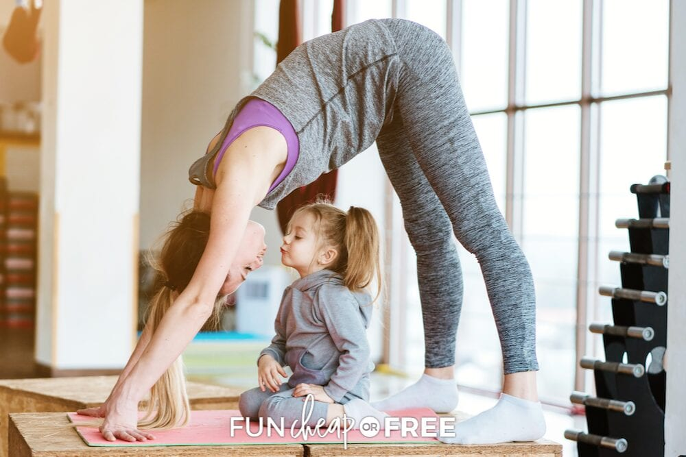 mom doing yoga with kid, from Fun Cheap or Free