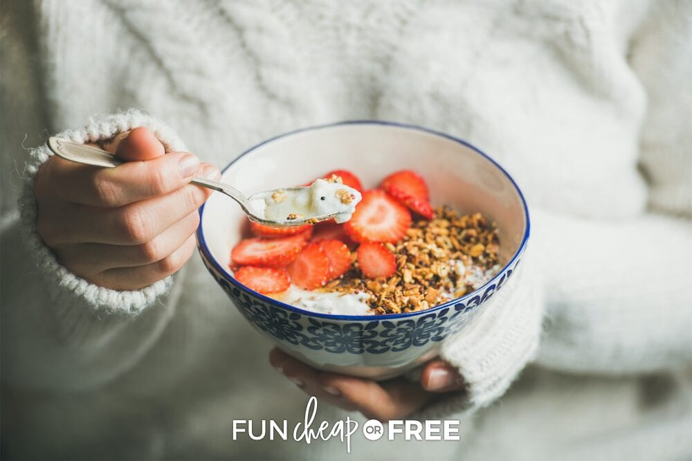 Woman holding bowl of yogurt and granola, from Fun Cheap or Free