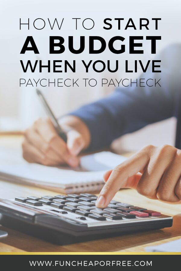 A woman using a budget journal and calculator to live paycheck to paycheck, from Fun Cheap or Free