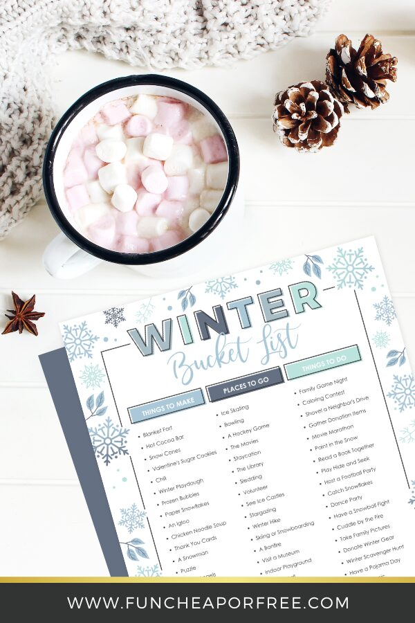winter bucket list and hot chocolate on a counter, from Fun Cheap or Free