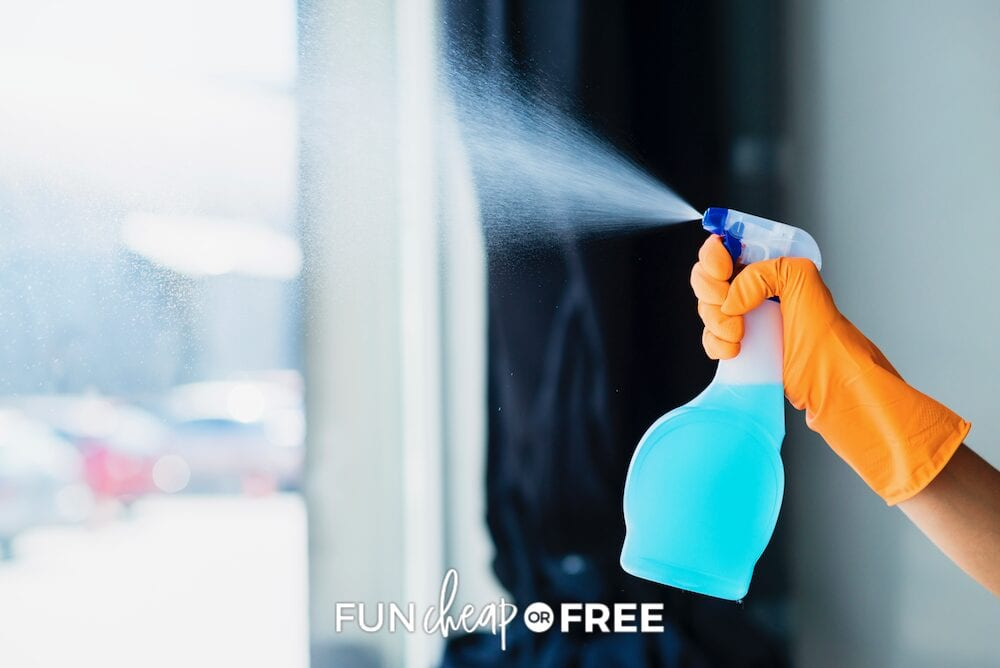 Hand spraying glass cleaner onto window, from Fun Cheap or Free