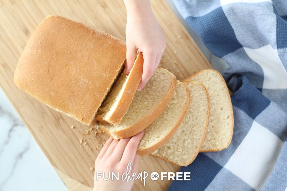 Kids who learned how to bake bread grabbing slices, from Fun Cheap or Free