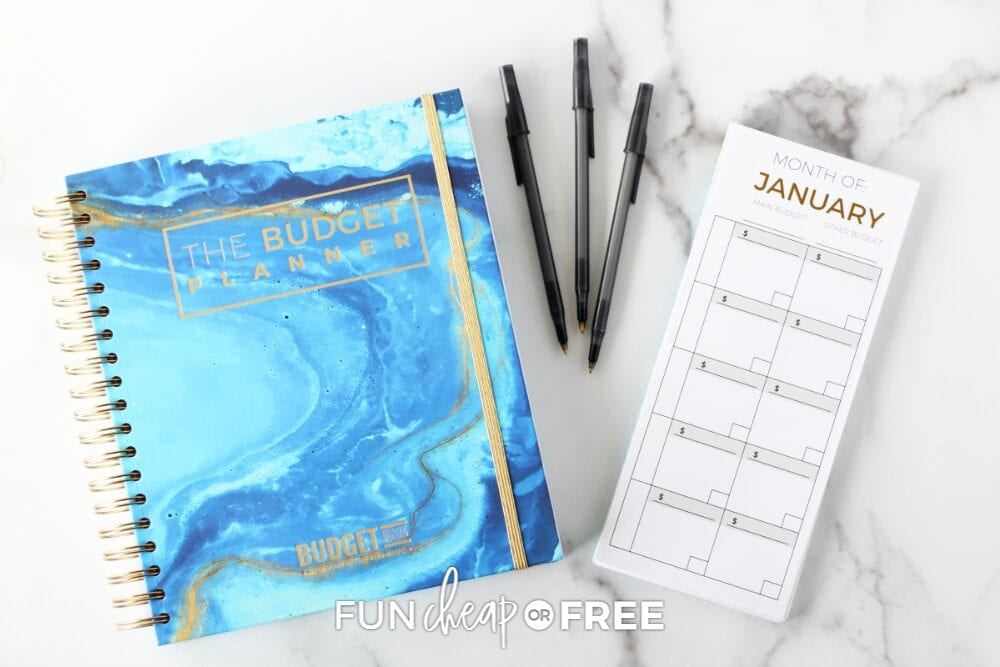 Budget planner and envelopes on a counter, from Fun Cheap or Free