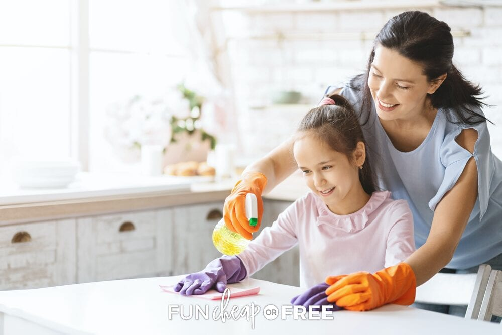 Mom and kid cleaning a counter, from Fun Cheap or Free