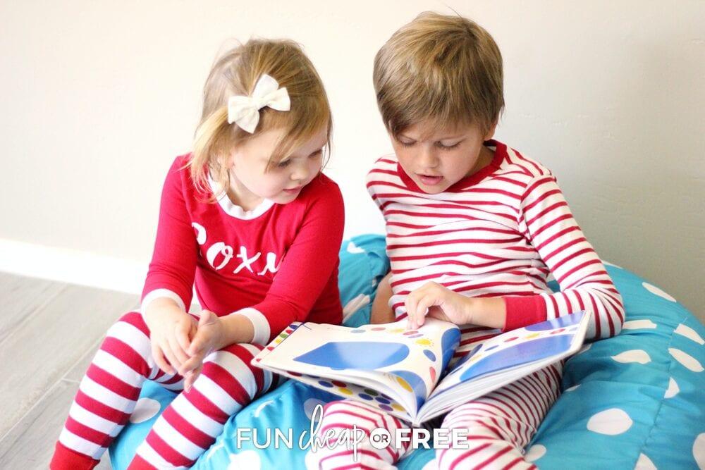 Kids reading books on a bean bag chair, from Fun Cheap or Free