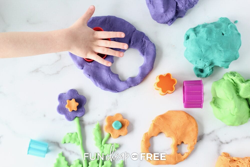 Kid using cutter with playdough, from Fun Cheap or Free