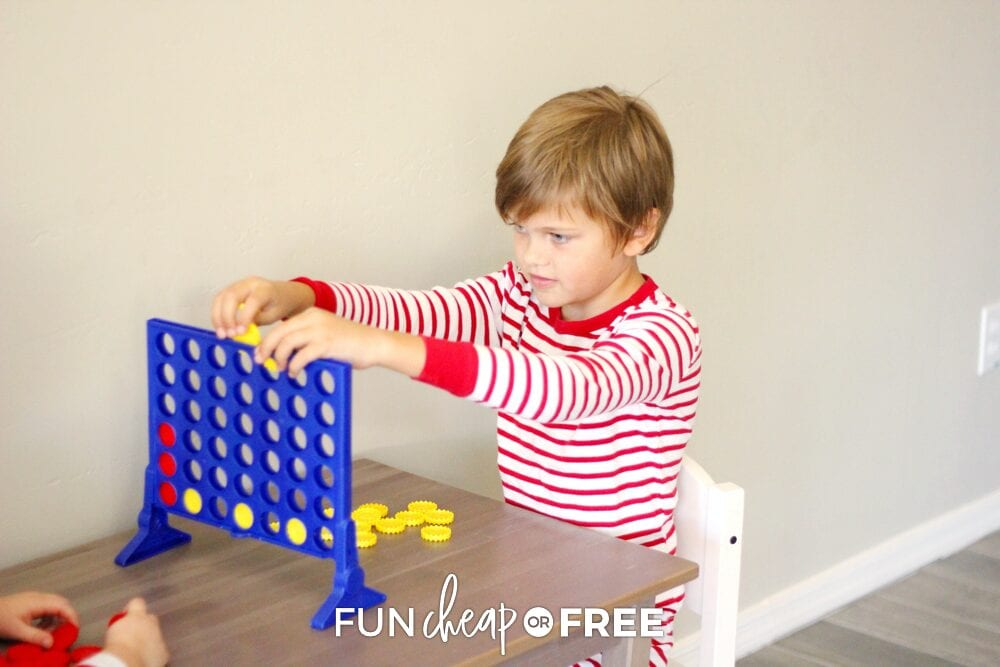 Kids playing connect four, from Fun Cheap or Free
