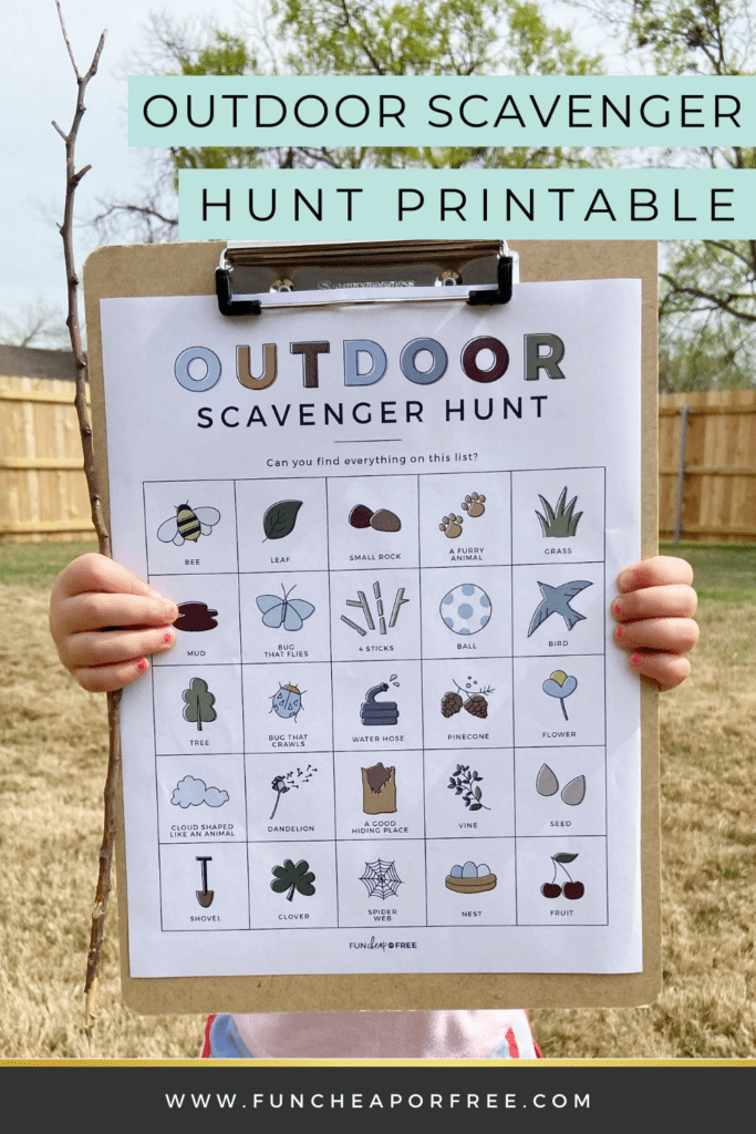 Little girl holding outdoor scavenger hunt printable, from Fun Cheap or Free