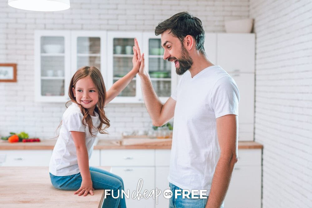 Dad giving daughter a high five, from Fun Cheap or Free