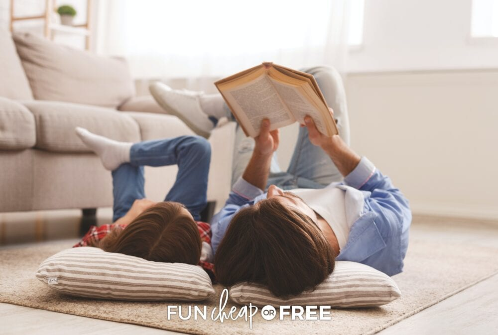 Father and daughter reading a book together, from Fun Cheap or Free
