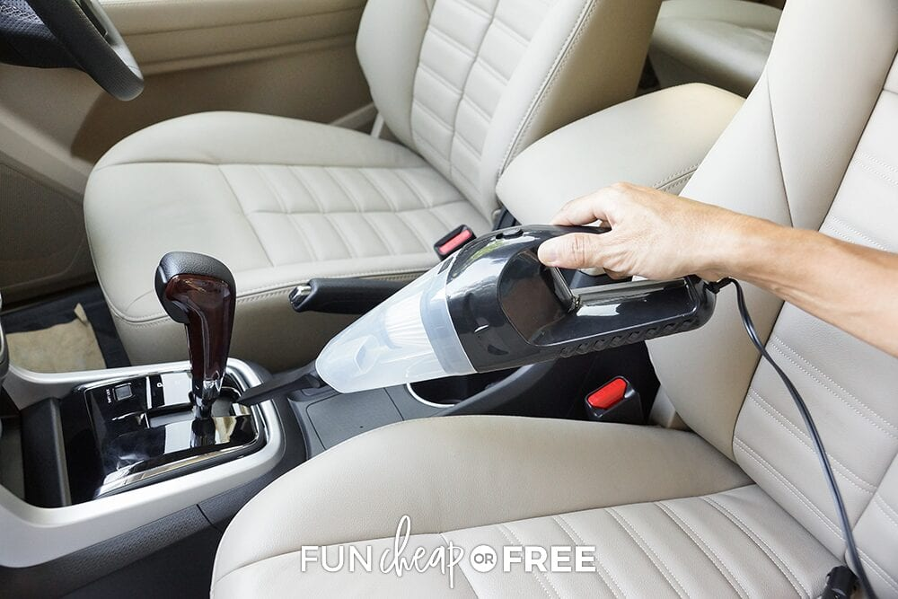 Hand using car vacuum, from Fun Cheap or Free