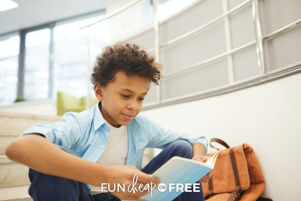 Boy reading a book on the stairs, from Fun Cheap or Free