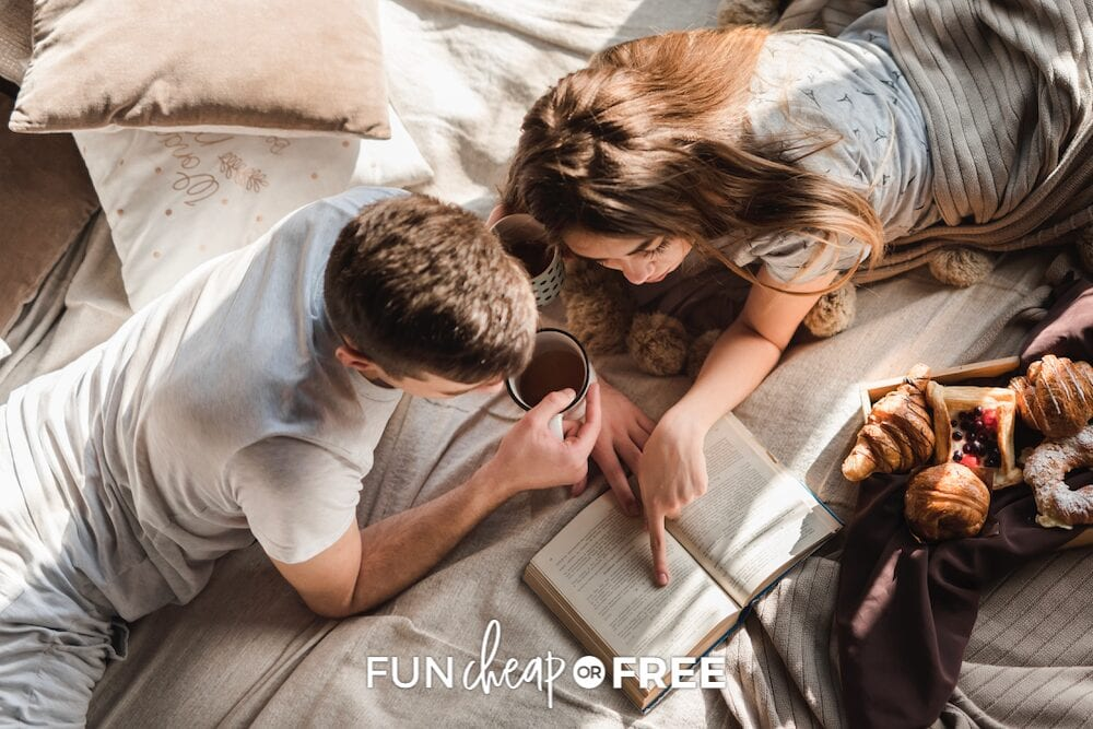Couple looking at a book together, from Fun Cheap or Free