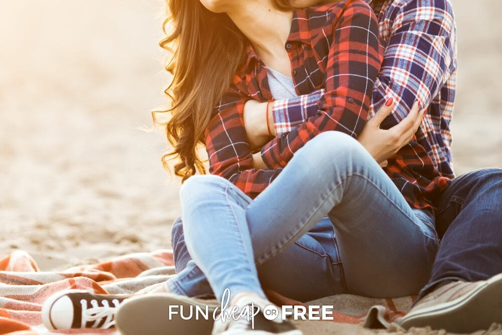 Couple snuggling on the beach, from Fun Cheap or Free