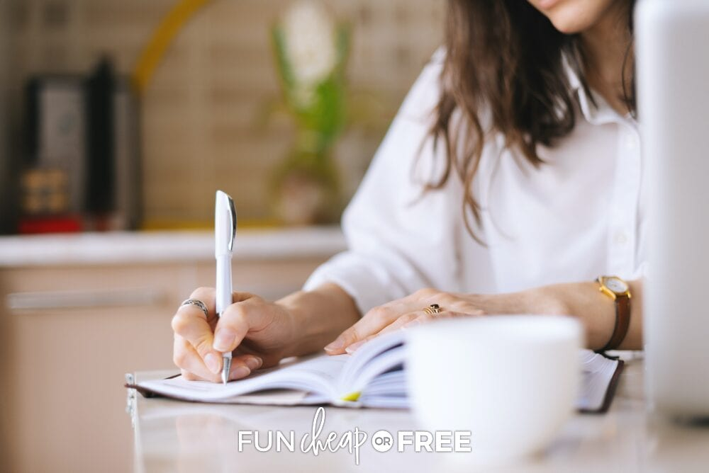 Woman writing down positivity challenge items, from Fun Cheap or Free