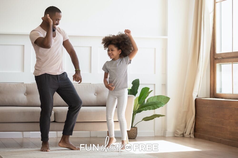 Father and daughter dancing in living room, from Fun Cheap or Free