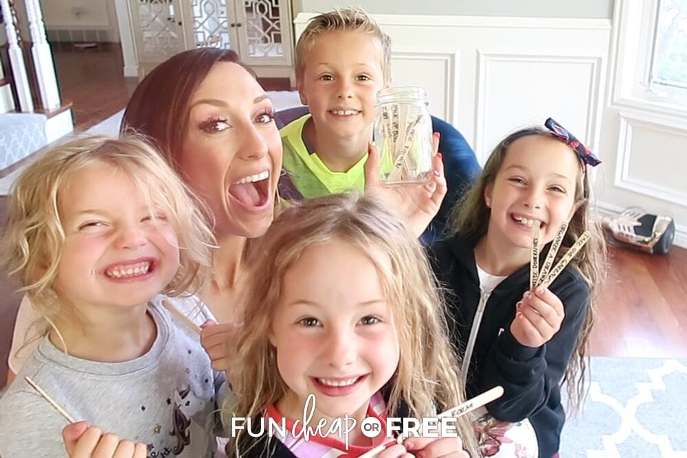 Jordan Page and her kids with chore sticks, from Fun Cheap or Free