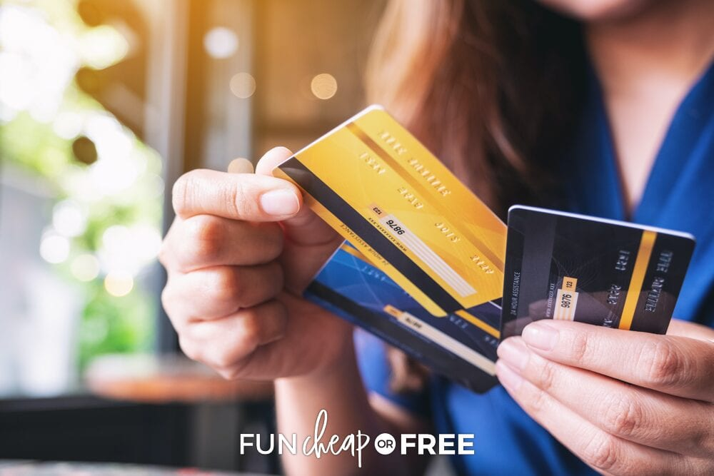 A woman holding credit cards, from Fun Cheap or Free