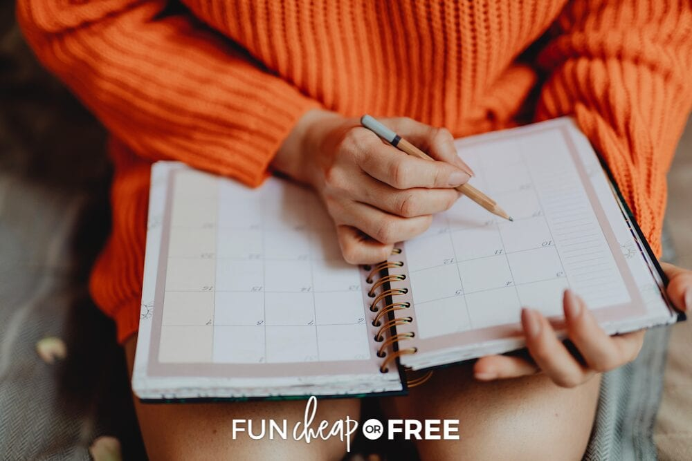 Woman writing in planner, from Fun Cheap or Free