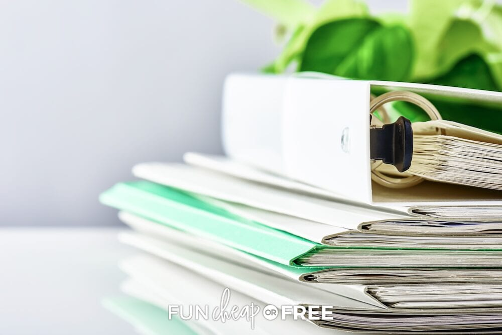 Get rid of paper clutter like this stack of paper from Fun Cheap or Free!