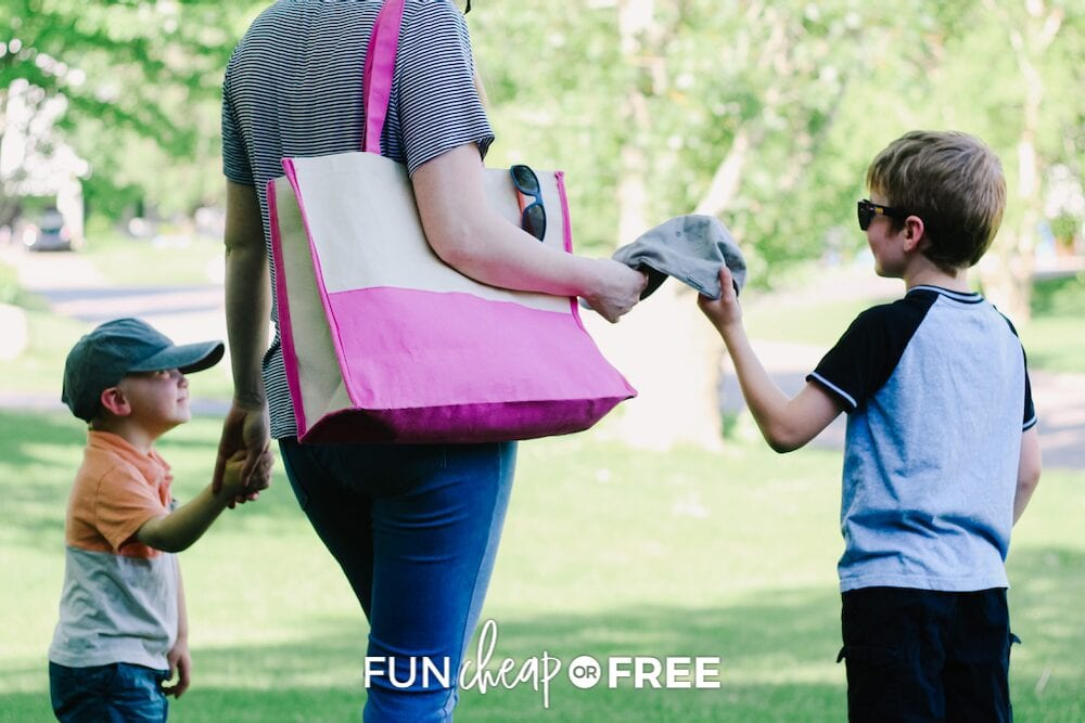 mom with sons at the park with a  summer essentials bag, from Fun Cheap or Free