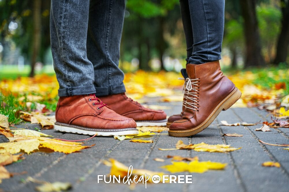 A man and woman's boots. The woman is standing on her tiptoes, from Fun Cheap or Free