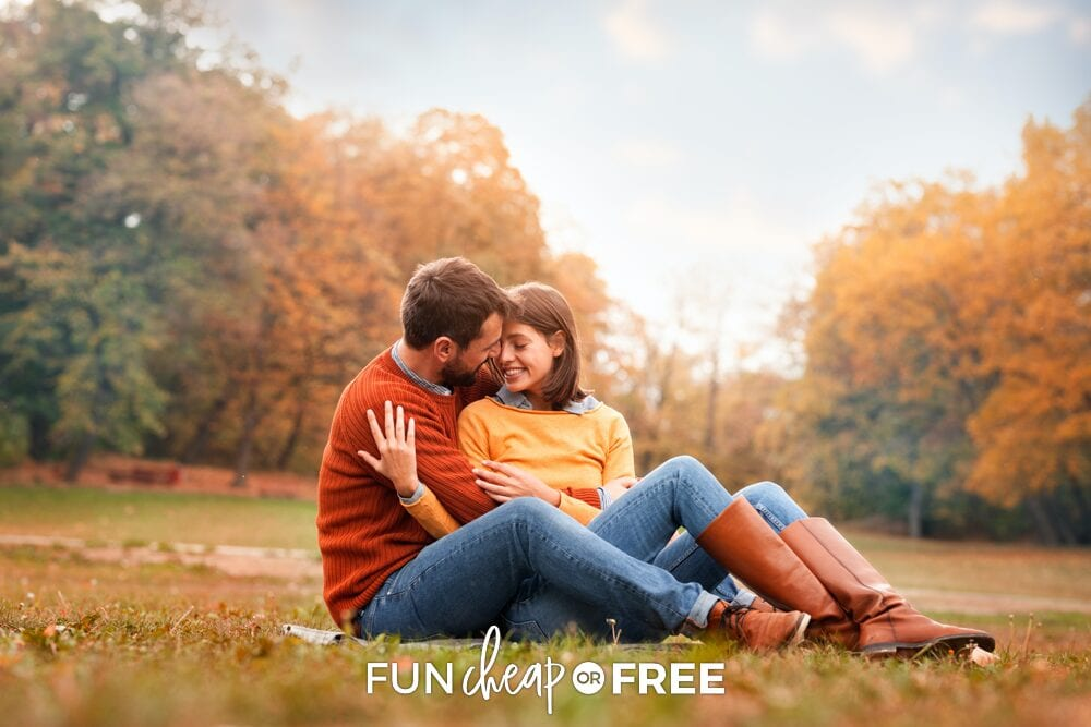 A man and a woman in a field with fall leaves on the trees, from Fun Cheap or Free!