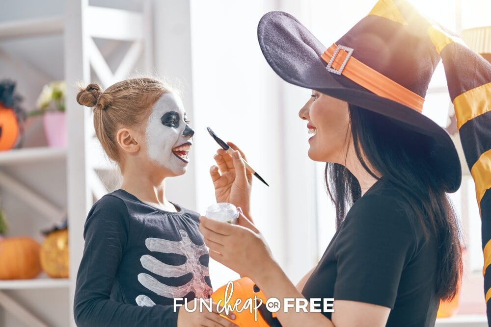 Mother painting daughter's face for Halloween, from Fun Cheap or Free