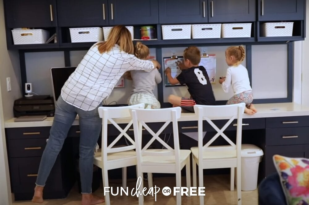 Jordan helps her kids with their clipboards, from Fun Cheap or Free