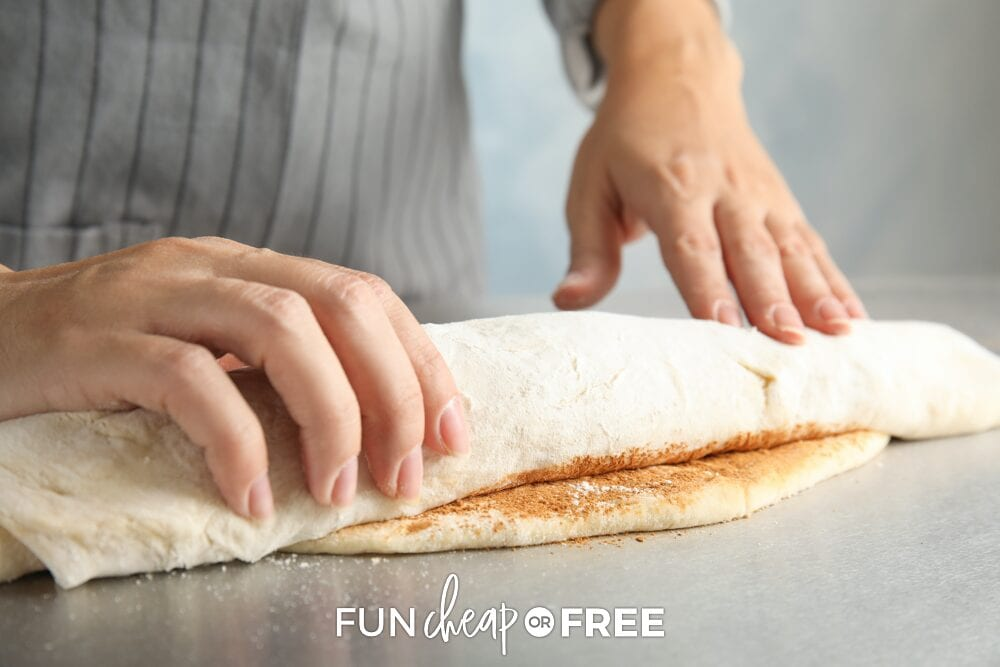 Hands rolling up dough on a counter, from Fun Cheap or Free