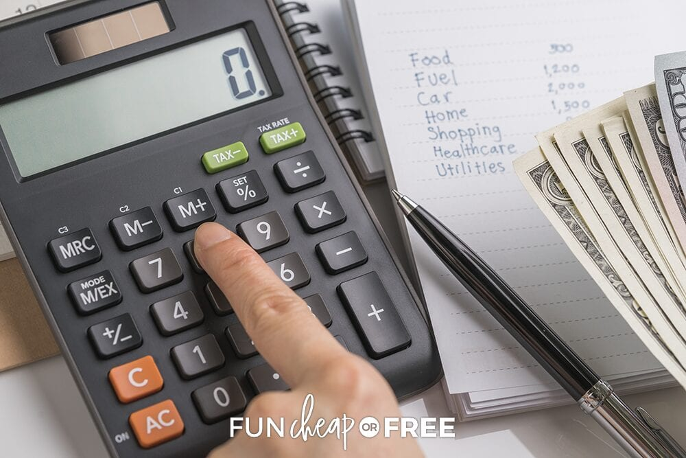 Pressing a calculator button next to a budget list and cash, from Fun Cheap or Free