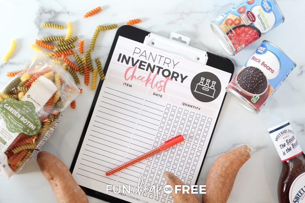 Pantry inventory checklist on a clipboard surrounded by pantry items, from Fun Cheap or Free
