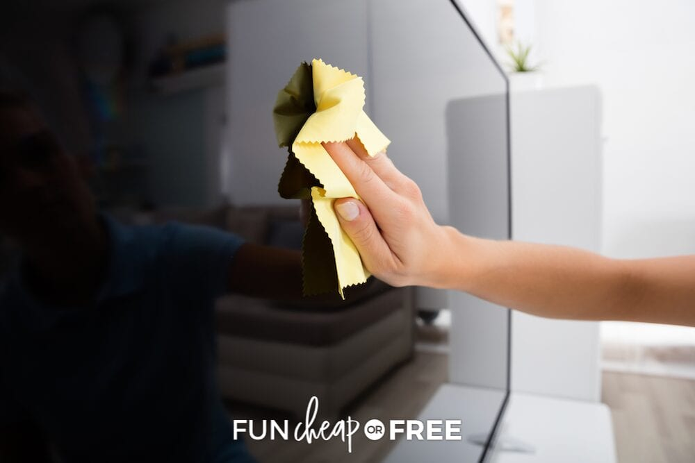 Hand wiping down the tv, from Fun Cheap or Free