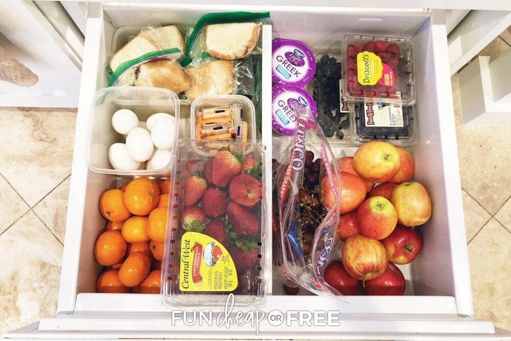 Refrigerator drawer with snacks for kids, including fresh fruit and hard-boiled eggs, from Fun Cheap or Free