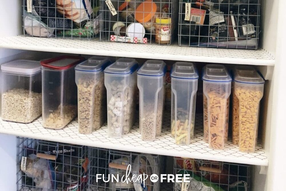 Snack and cereal containers lined up in the pantry from Fun Cheap or Free