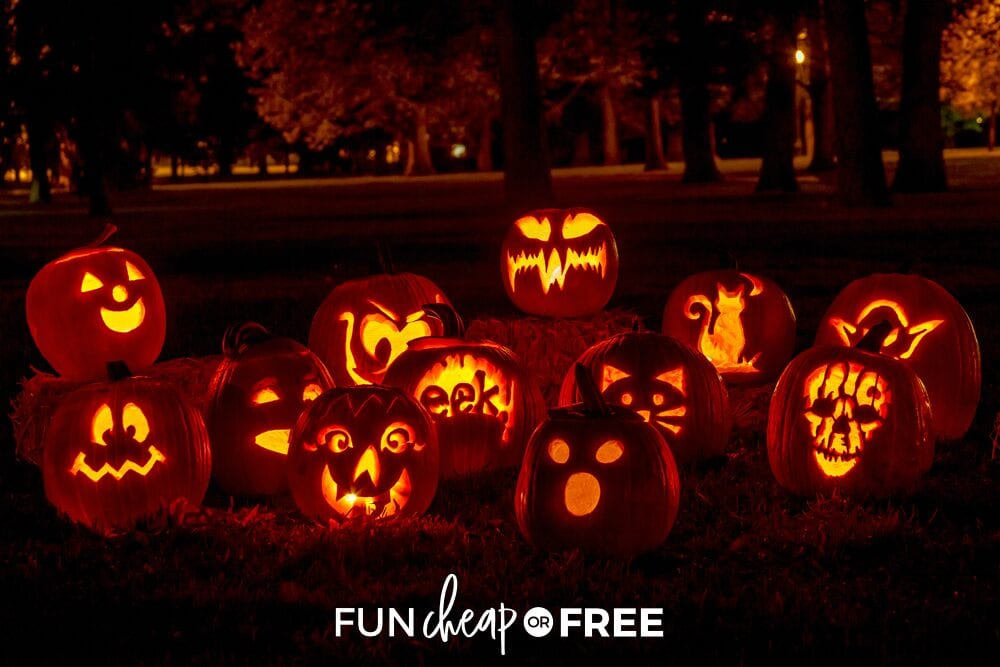 Various carved pumpkins outside lit up at night, from Fun Cheap or Free
