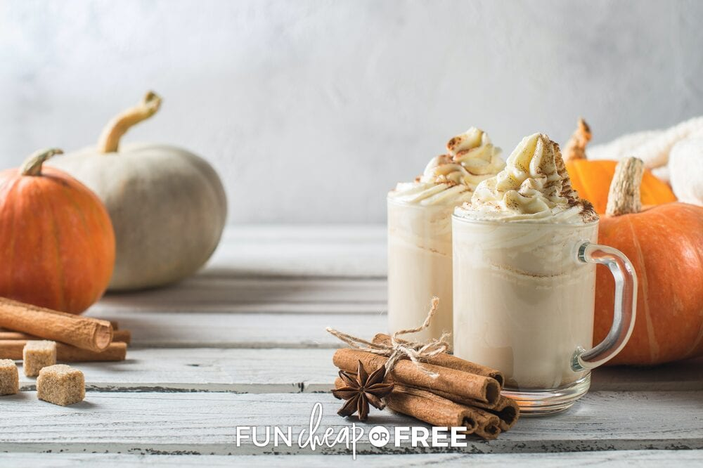 Pumpkin spice lattes on a wooden background with pumpkins in the background, from Fun Cheap or Free