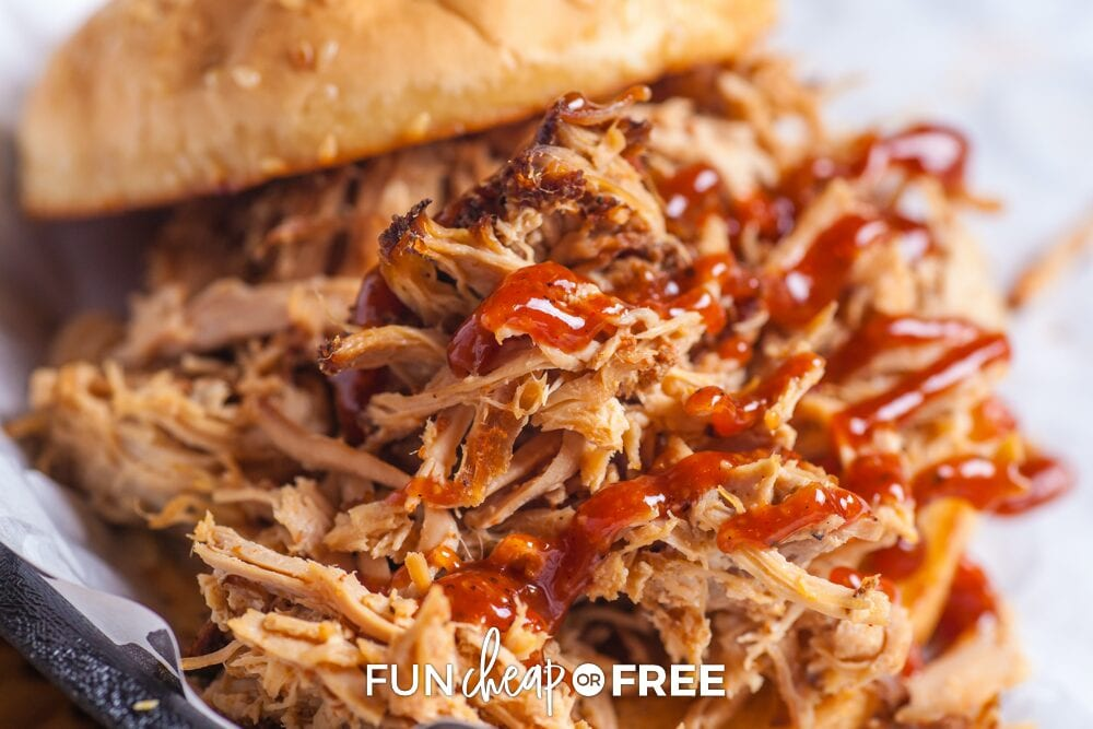 Pulled pork on a bun drizzled with barbecue sauce in a basket showing you how to repurpose leftovers, from Fun Cheap or Free