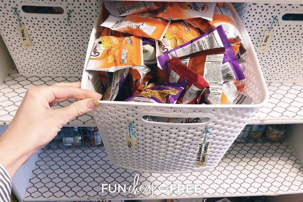 Jordan's hand pulling open a snack and lunch bin, from Fun Cheap or Free