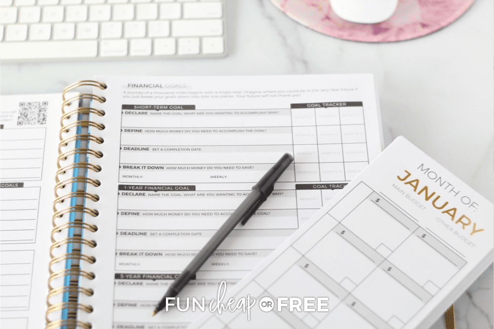 Open Budget Planner with pen and Budgeting Envelope from Jordan Page and Fun Cheap and Free