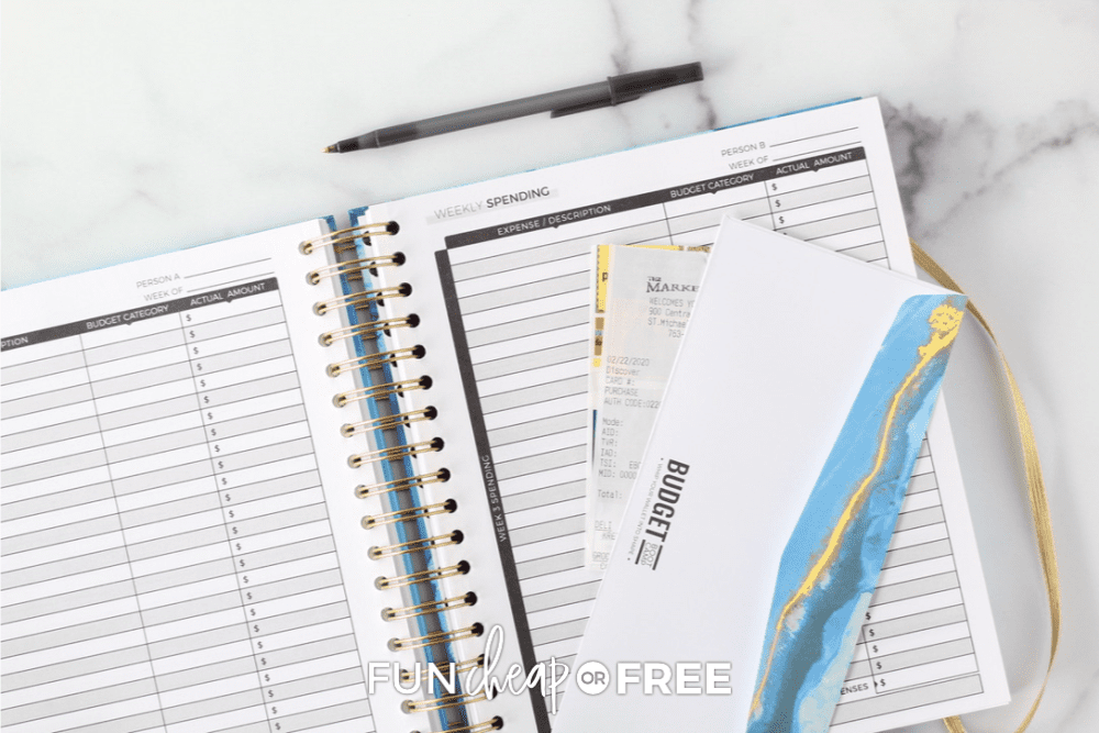 Open daily budget planner, grocery receipt and budgeting envelope from Fun Cheap or Free