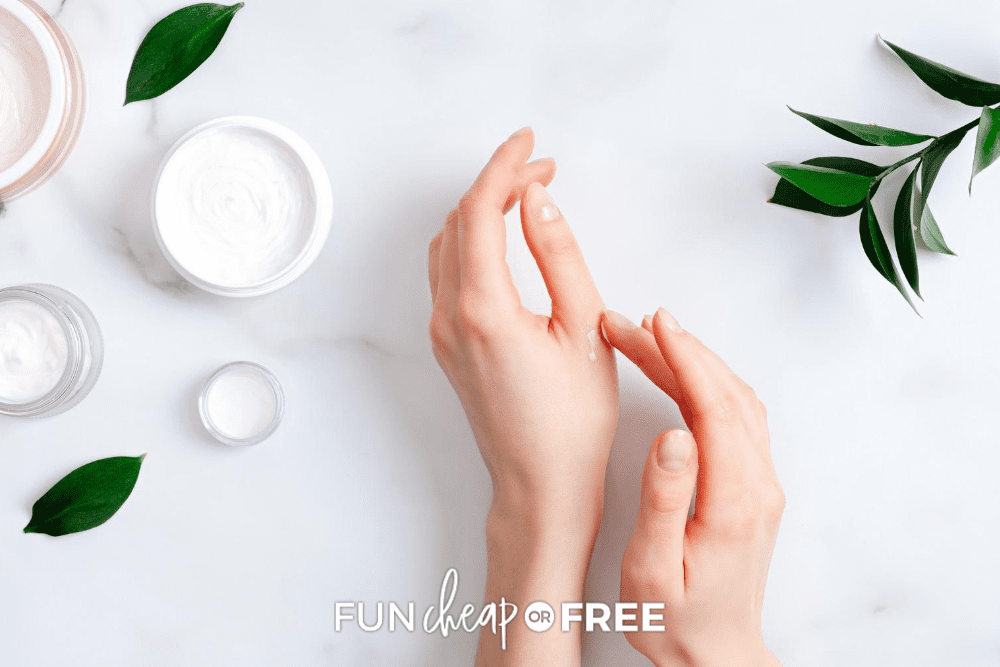 a woman rubbing lotion on her hands from Fun Cheap or Free