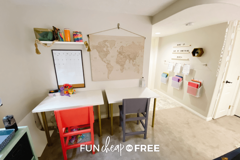 Homeschool room with tables, wall wire folder hangers, and a world map, from Fun Cheap or Free