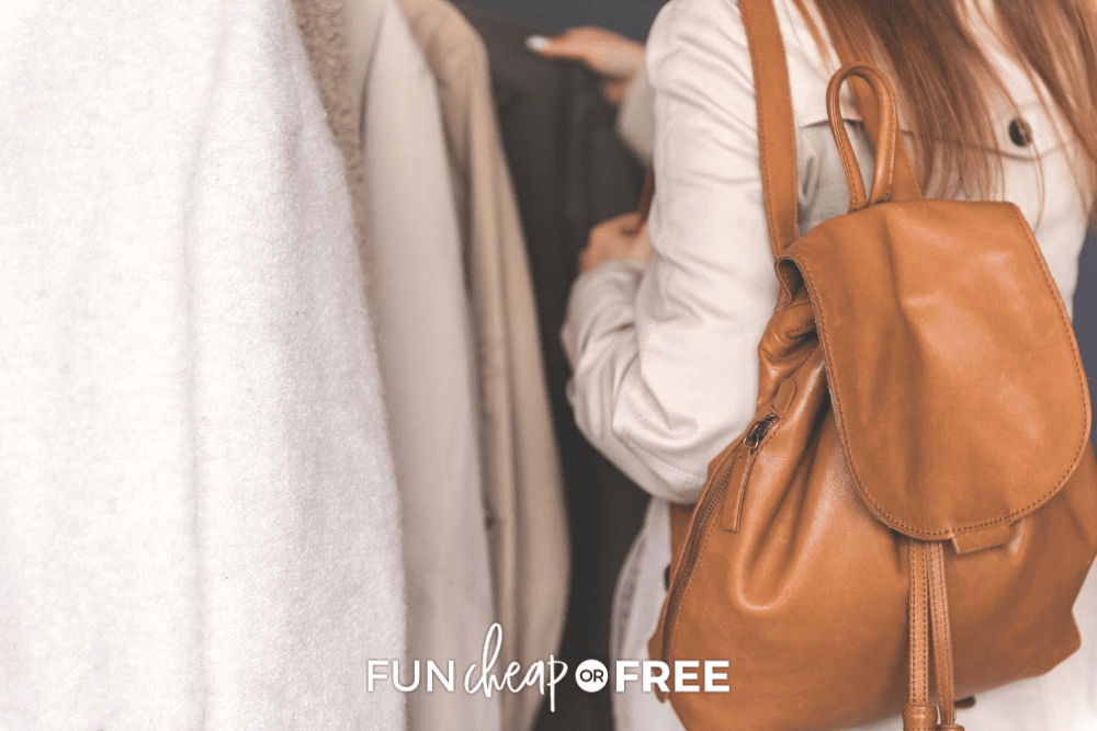 Woman wearing a backpack looking at coats in the closet, fro Fun Cheap ir Free
