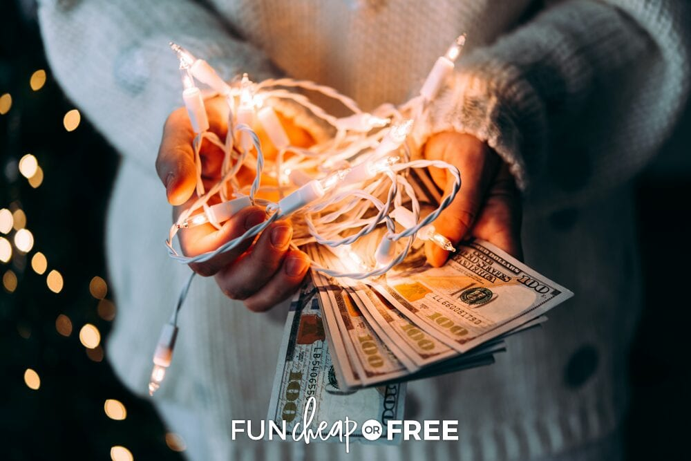Hands holding Christmas lights and money, from Fun Cheap or Free