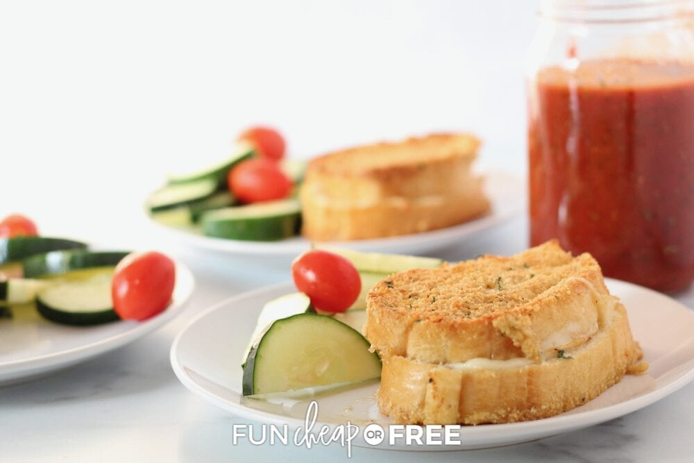 Sandwich on a plate with cucumbers and tomatoes, from Fun Cheap or Free